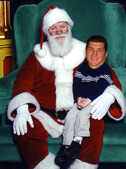 Tebow Sitting On Santa's Lap